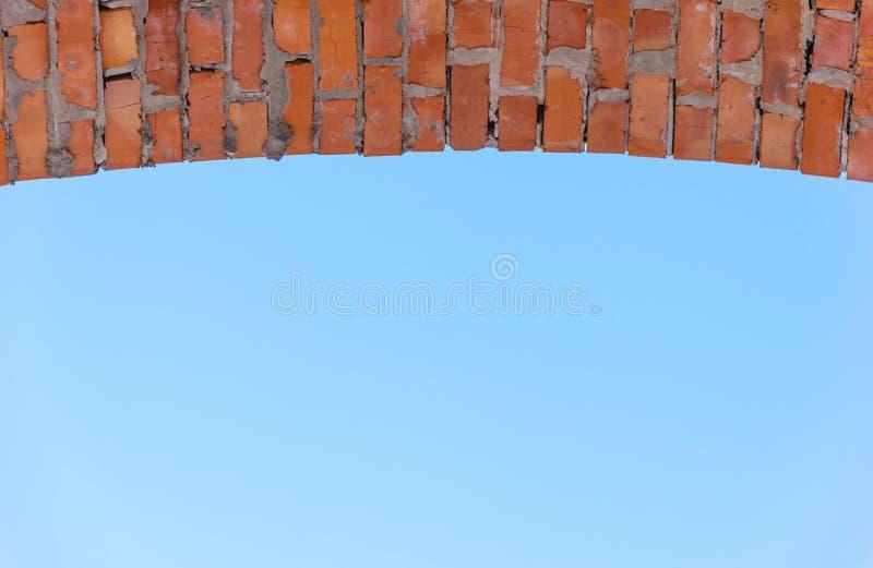 Brick arch on blue sky background, copy space. Brick arch on blue sky background royalty free stock photo