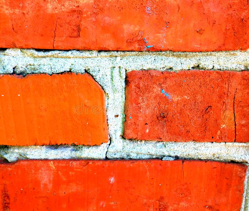 Brick background, pleasing the eye with its red color. Streak of cement royalty free stock image