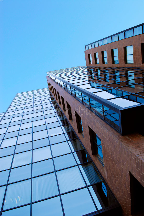 Brick and Blue. Brick and glass office building royalty free stock photos