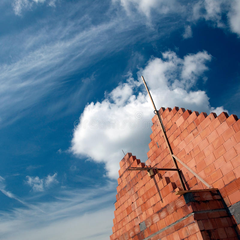 Brick building and cloudscape royalty free stock image
