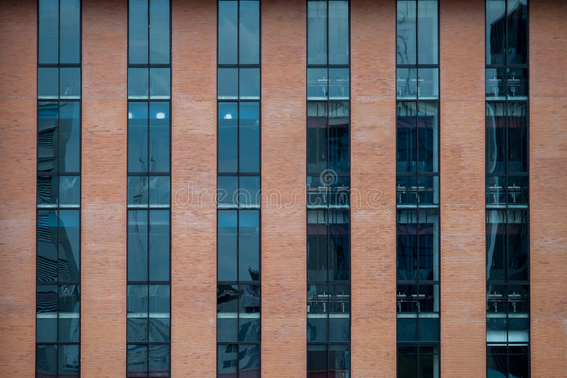 Brick Building Facade with a Blue Glass for Texture. Brick Building Facade with a Blue Glass stock photo