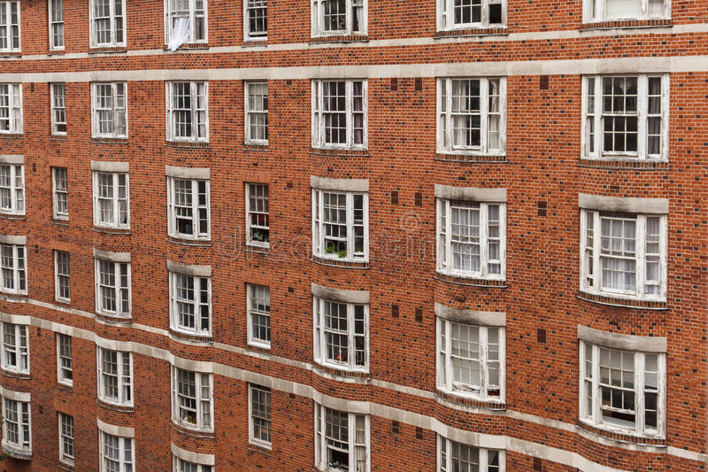 Brick building facade - tenement building exterior, England.  stock photography