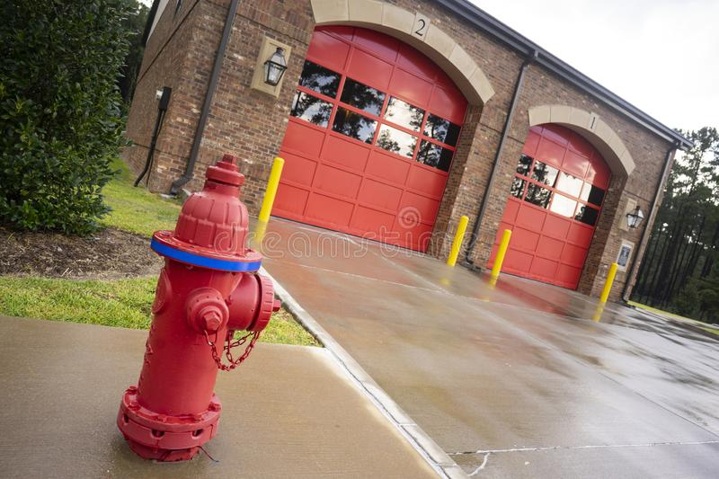 Brick Building Red Garage Doors Local Fire Department Station stock photos