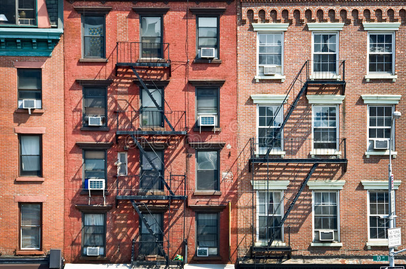Brick buildings with outside fire escape stairs, USA stock photography
