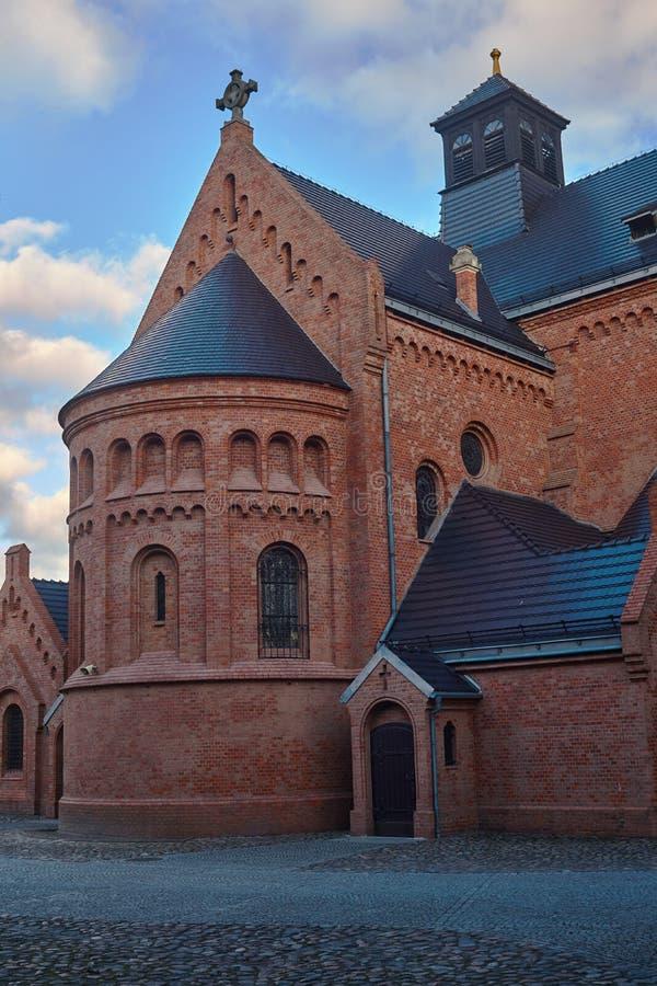 Brick Catholic Church in basilica neo-Romanesque style stock photo