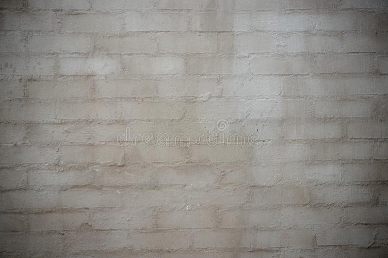 Brick and cement / concrete wall texture or background stock photography