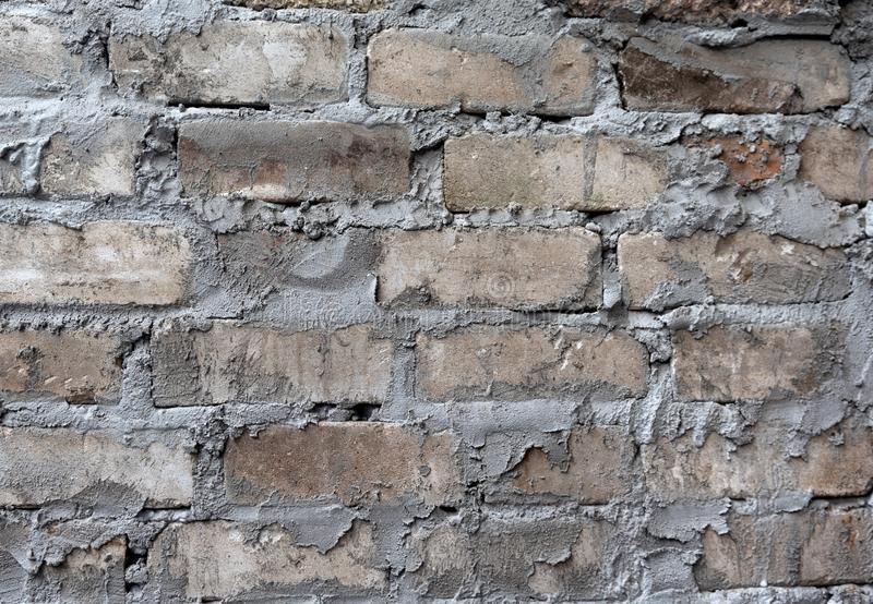 Brick and cement wall close up as a background royalty free stock image