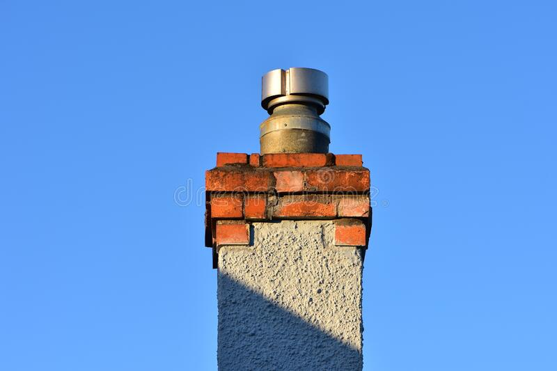 Brick chimney with metal liner stock photo