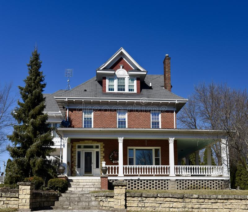 A Brick Colonial. This is a Winter picture of a brick house located in Bellevue, Iowa in Jackson County. This 19th century brick house is an example of Colonial royalty free stock image