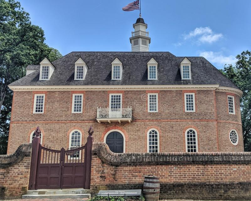 Colonial Williamsburg Capitol Building. Brick construction Colonial revival architecture reconstruction of original Capital building with blue sky on sunny day stock image