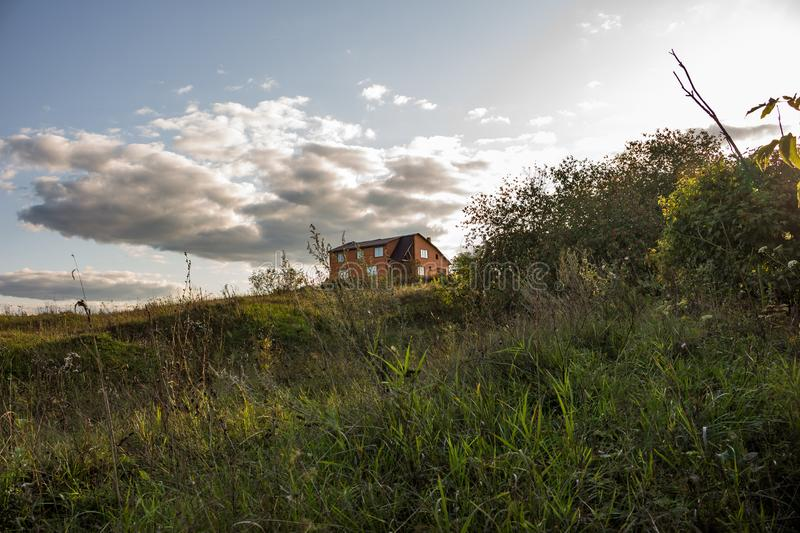 Brick country house on a deserted hill royalty free stock images