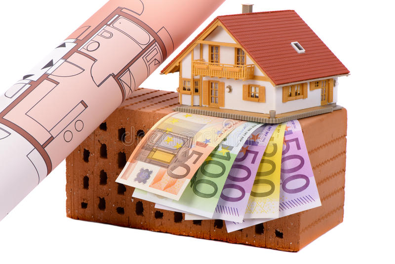 Brick and euro money with model house stock photography