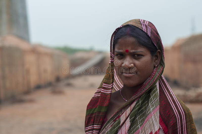 Brick Factory in India. KOLKATA - OCTOBER 26 : A woman worker - one of many women working in brick manufacturing industry where they live and work under royalty free stock photography