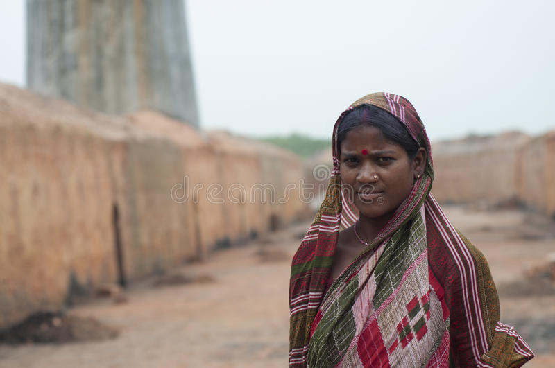 Brick Factory in India. KOLKATA - OCTOBER 26 : A woman worker - one of many women working in brick manufacturing industry where they live and work under stock photos