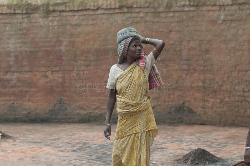 Brick Factory in India. KOLKATA - OCTOBER 26 : A woman worker-one of many women working in brick manufacturing industry where they live and work under unhealthy royalty free stock image