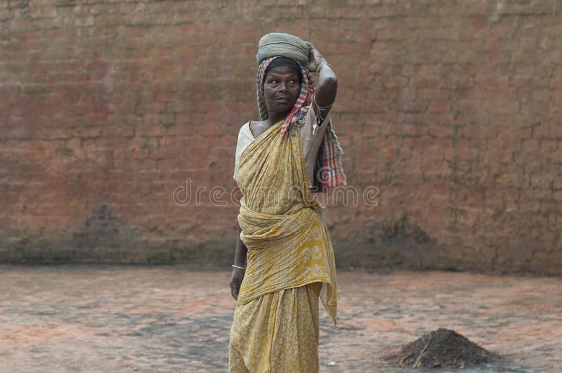 Brick Factory in India. KOLKATA - OCTOBER 26 : A woman worker-one of many women working in brick manufacturing industry where they live and work under unhealthy royalty free stock photo