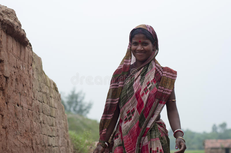 Brick Factory in India. KOLKATA - OCTOBER 26 : A woman worker - one of many women working in brick manufacturing industry where they live and work under stock photo
