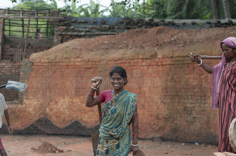 Brick Factory in India. KOLKATA - OCTOBER 26 : Women workers working in brick manufacturing industry where they live and work under unhealthy and unsafe royalty free stock image