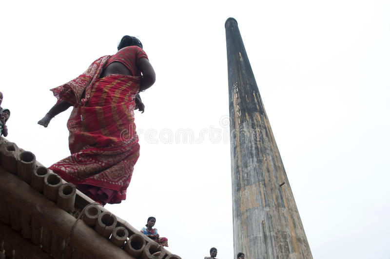 Brick Factory. KOLKATA - OCTOBER 26 : A mother carrying her child to the workplace-one of many girls working in brick manufacturing industry where they live and stock photos