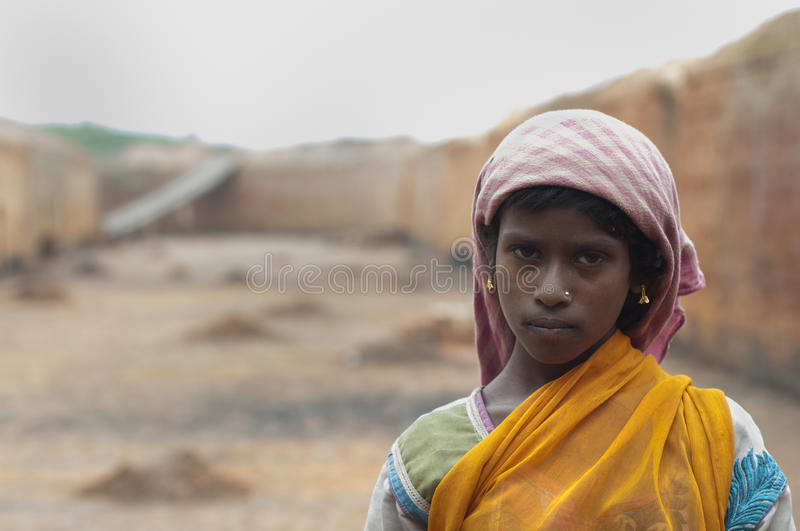 Brick Factory. KOLKATA - OCTOBER 26 : A teenage girl - one of many girls working in brick manufacturing industry where they live and work under unhealthy and stock photo