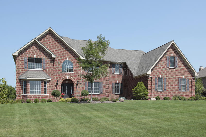 Brick home with arched entry. Large brick home with arched entry stock image