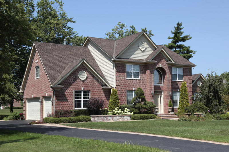 Brick home with arched entry. Brick home in suburbs with arched entry royalty free stock photo
