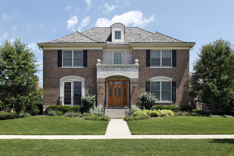 Brick home with front archway stock images