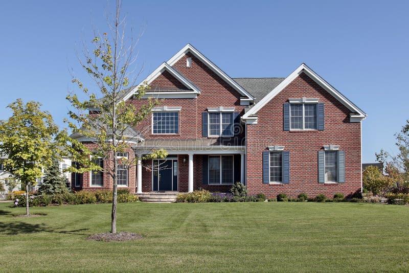 Brick home with front door columns stock image