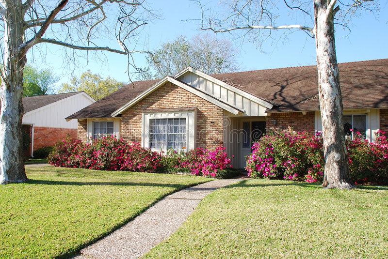 Download Brick Home With Pink Azaleas Stock Image - Image: 4536317