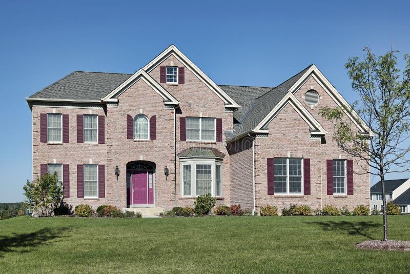 Brick Home With Pink Door Stock Images Image 12523884