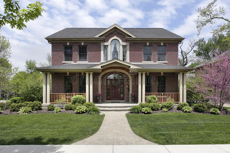 Brick home with white columns royalty free stock image