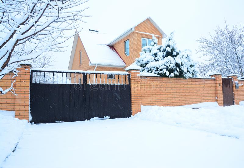 Brick house covered snow in winter stock photos