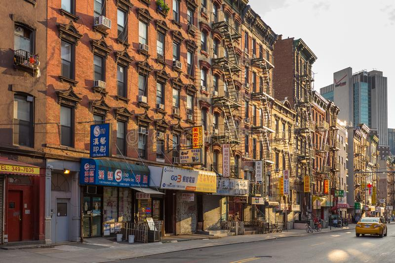 Brick house with Fire ladder in streets in Down Manhattan, Chinatown. New York, NY, USA- August 25, 2017: Brick house with Fire ladder in streets in Down royalty free stock photography