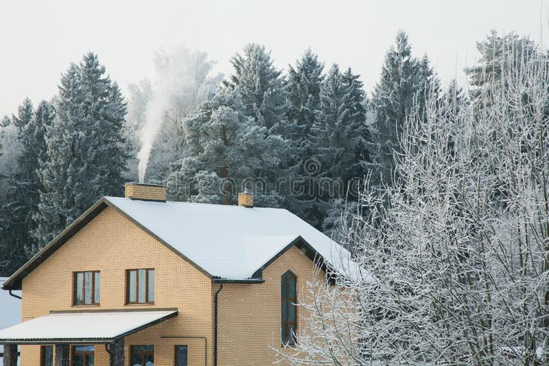 Brick house on a frosty winter day. Among the trees royalty free stock photos