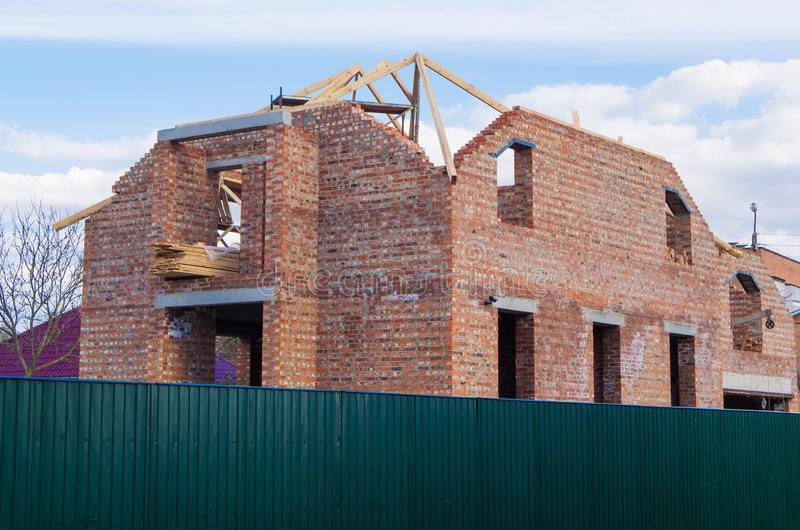 Brick house under construction with unfinished roof stock images