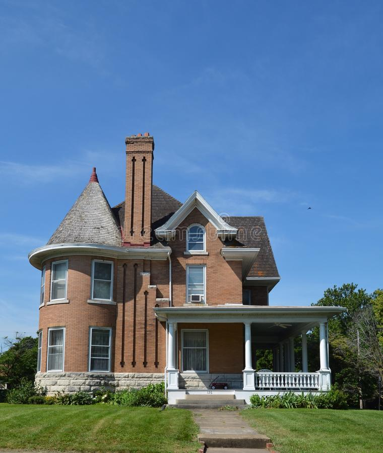 Brick Italianate. This is a Summer picture of a hill top house located in Keokuk, Iowa. The brick house built in the 1890s is an example of Italianate royalty free stock photos