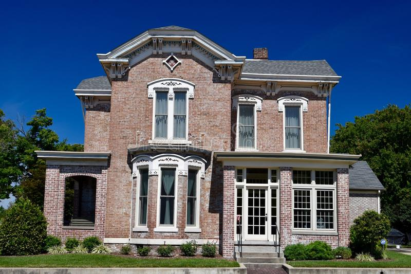 A Brick Italianate. This is a Summer picture of a brick house located in Seymour, Indiana in Jackson County. This house is a classic example of Italianate royalty free stock images