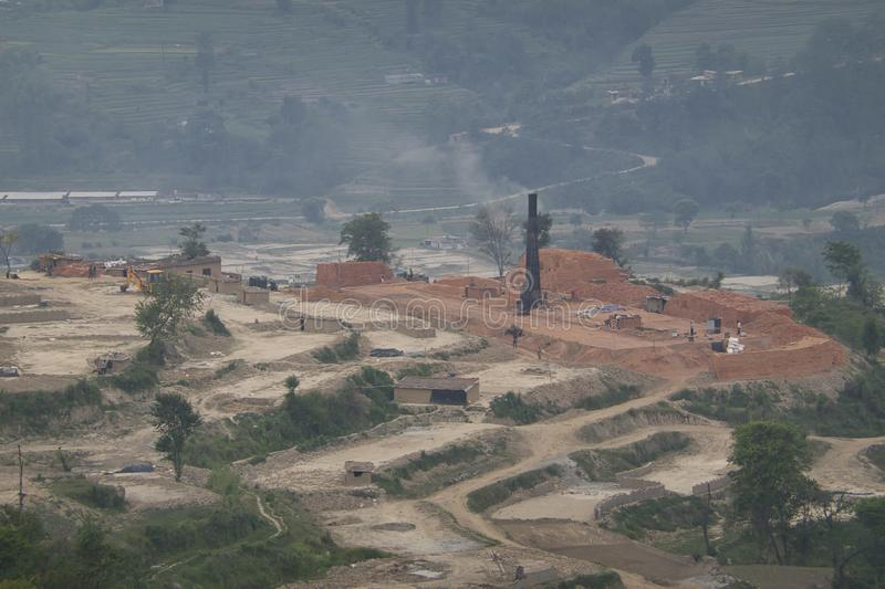 Brick Kiln Pollution. The pollution spewing out of the chimneys of brick kilns in Asia royalty free stock photo