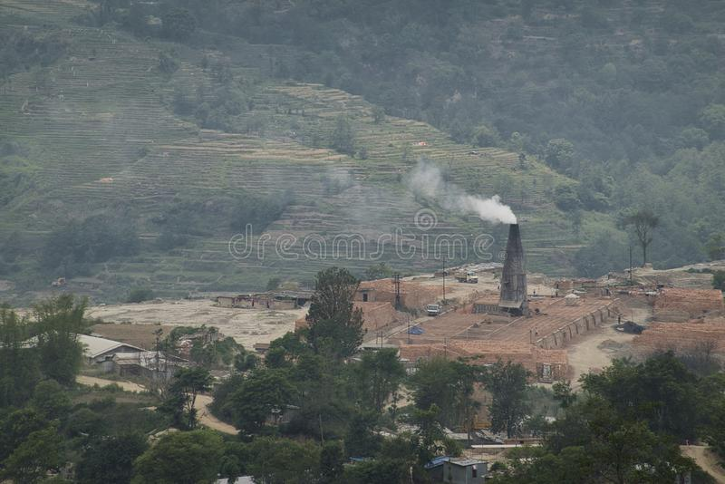 Brick Kiln Pollution. The pollution spewing out of the chimneys of brick kilns in Asia stock photo