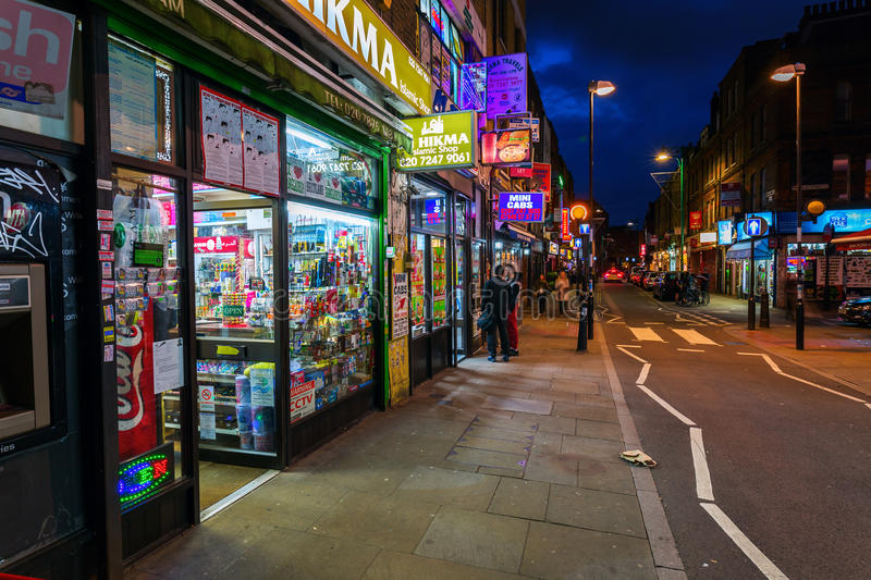 Brick Lane in the London district Shoreditch at night stock photos