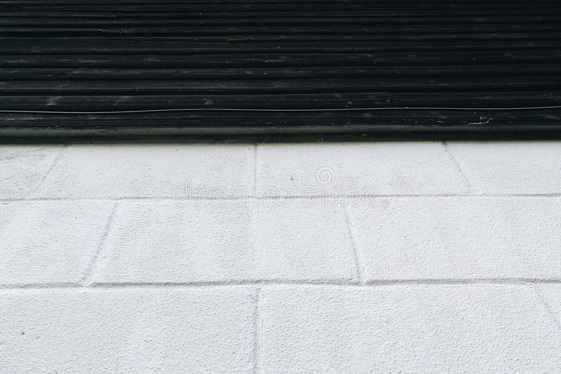 Brick layer blue on dark wood wall stock image