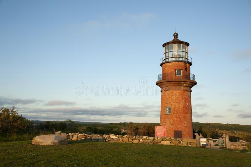 Brick Lighthouse Surrounded by Stone Wall on Island in Massachusettes stock images