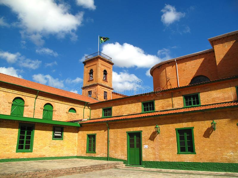 Old brick buildings and flag tower royalty free stock photography