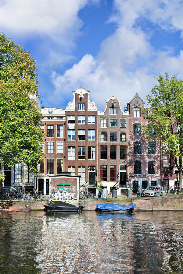 Brick mansions in the Amsterdam historical canal belt. royalty free stock image