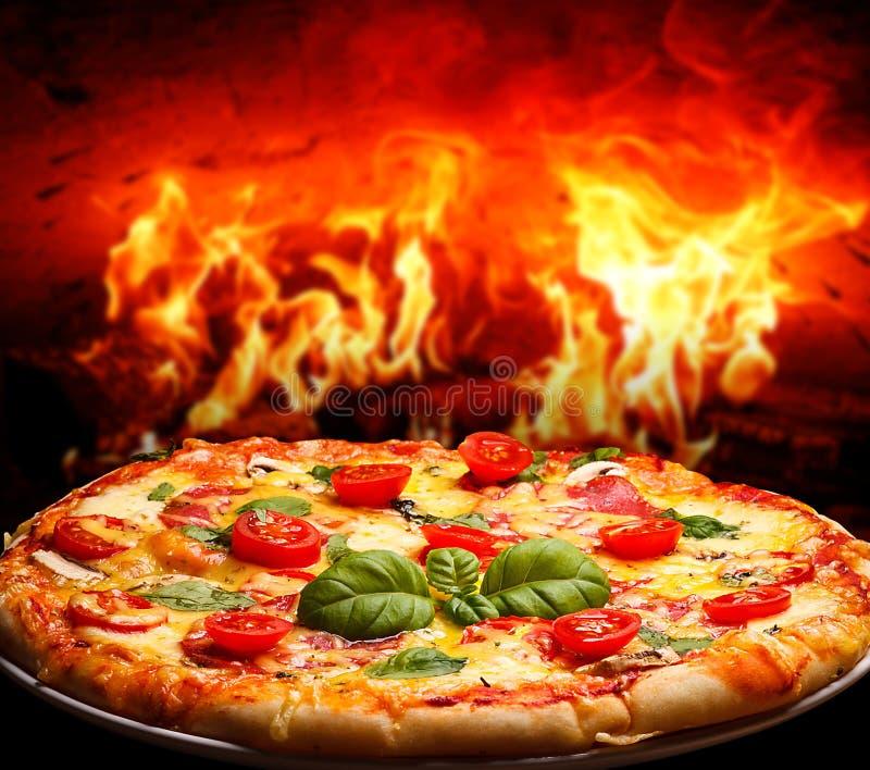 Brick oven pizza royalty free stock photos