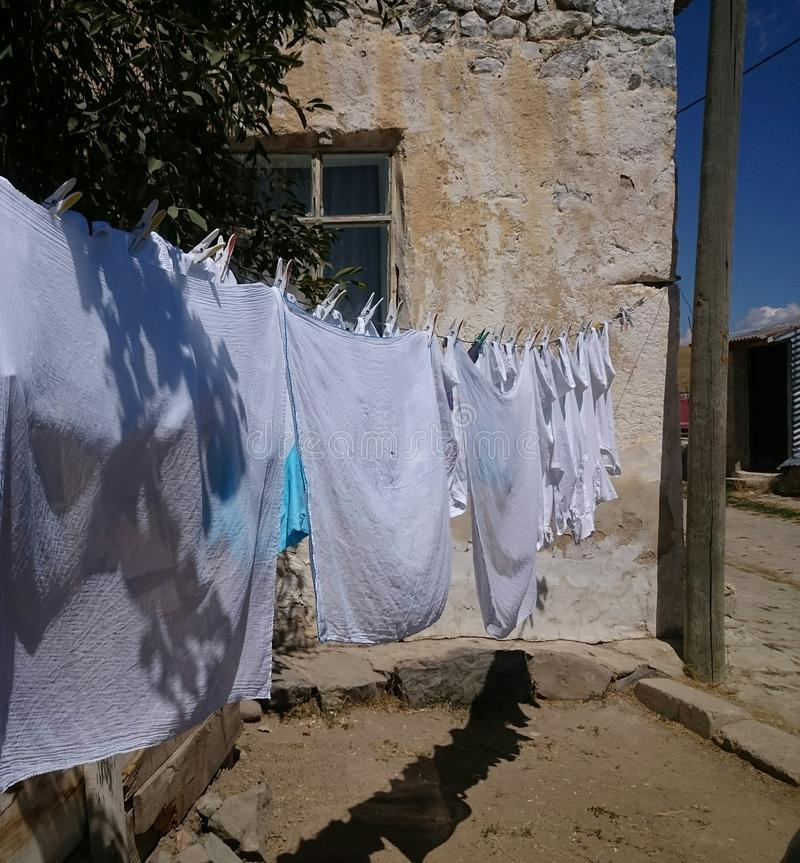 hanging clothes outside the house royalty free stock images