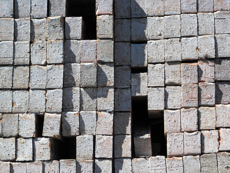 Brick Palette. A stacked palette of gray new bricks with gaps stock images