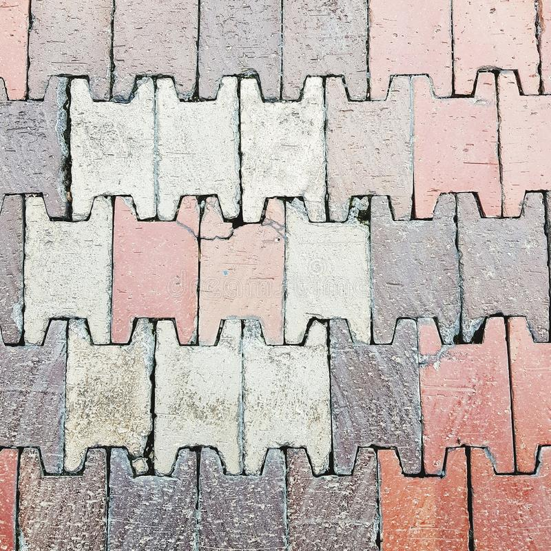 Brick pavement and floor exterior. Home, house, pathway, walkway, textured, wallpaper, background, backdrop, abstract, full-frame, tiles, flooring, pattern stock photo