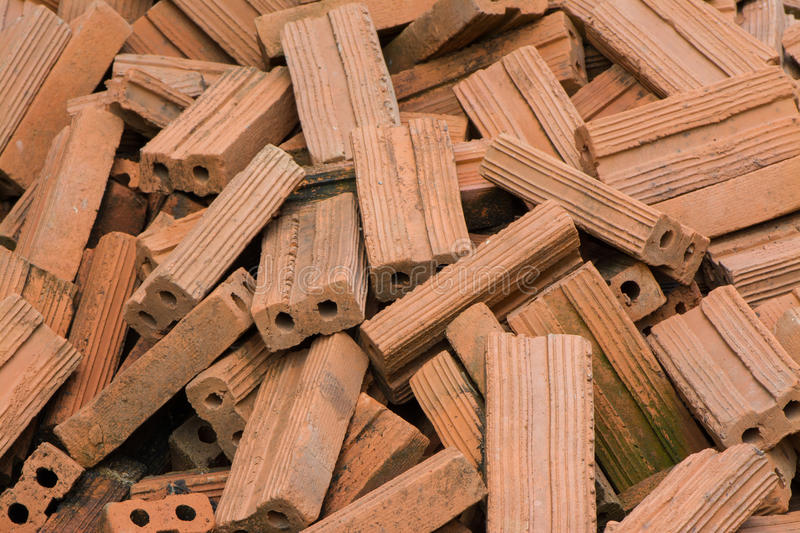 Brick pile. The piled old bricks of red color. were used for construction royalty free stock image