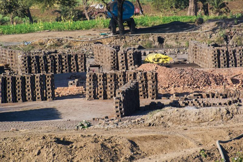 Brick Piles Brick kiln and Brick Manufacturing Site India. Brick Pile of raw Bricks which are Sun drying at Construction Brick kiln and Brick Manufacturing Site royalty free stock photography